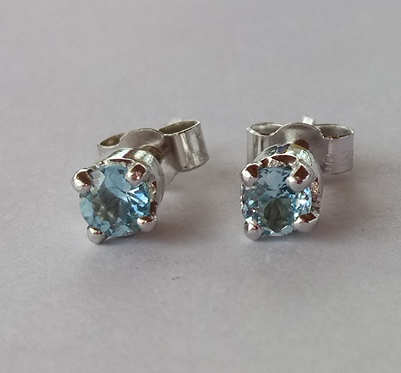 Silver ear studs with topaz